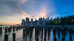 Brooklyn Bridge Park Time Lapse Photo (20190609-DSC05457-Edit v2) (Michael.Lee.Pics.NYC) Tags: newyork brooklyn brooklynbridgepark pier1 pilings posts eastriver sunset twilight night lowermanhattan wtc worldtradecenter architecture cityscape sony a7rm2 laowa12mmf28 magicshiftconverter composite