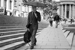 Banking On Rain (Silver Machine) Tags: london stpauls stpaulscathedral streetphotography street candid man businessman walking unbrella suit mono monochrome blackwhite bw fujifilm fujifilmxt3 fujinonxf35mmf2rwr