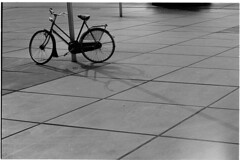 Pole position (Elios.k) Tags: horizontal outdoors nopeople bicycle old pole lightpole square abstract urban city transportation dutch fiets shadow pavement longshadow pattern geometry street streetphotography blackandwhite bw mono monochrome travel travelling may 2018 canon camera photography eindhoven kennedyplein northbrabant noordbrabant netherlands nederland europe film analoguephotography scannedfilm kodaktrix400 analogfilm grain contrast canona1 a1 analogcamera