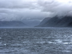 'Twas a dark and stormy afternoon (Digidoc2 - BACK) Tags: mountainrange mountain horizon hills landscape sea waves rain clouds grey seascape straightofmagellan water isolated