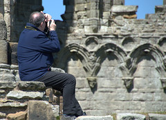 Man at Whitby Abbey ruins (Tony Worrall) Tags: whitbyabbey ruins man candid past iconic stone olden historic photo yorkshire yorks scene scenery northyorkshire resort yorkshirephotos east eastern seasidetown holidays tourists coast photographsofwhitby whitbyphotos whitby north update place location uk england visit area attraction open stream tour country item greatbritain britain english british gb capture buy stock sell sale outside outdoors caught shoot shot picture captured ilobsterit instragram
