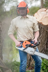 Man chopping wood with chainsaw wearing check shirt (Rydale Country Clothing) Tags: country clothing fashion yorkshire british style model models girl woman ladies shirt cotton top farmer farming farm lumber wood saw chainsaw male man
