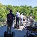 Männer auf einer Segway-Tour auf der Brücke Kabelsteg, an der Praterinsel in München