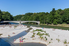 People living in the big city Munich, cooling off on hot summer days and bathing in the Bavarian river Isar, in Munich