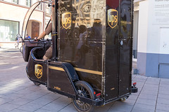 Bicycle courier and UPS delivery driver with tiny delivery van, drives environmentally friendly through the city centre in Munich to deliver parcels (verchmarco) Tags: germany flowfest munich münchen bayern deutschland street strase vehicle fahrzeug people menschen transportationsystem transportsystem city stadt car auto travel reise road wheel rad police polizei bike fahrrad bus vintage jahrgang old alt urban städtisch commerce handel door von stock festival truck lkw2019 2020 2021 2022 2023 2024 2025 2026 2027 2028 2029 2030 dawn colour outside bar village countryside eos mono bench ice
