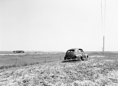 Put On Pasture ... (LarsHolte) Tags: pentax 645 pentax645 645n 6x45 smcpentaxa 35mm f35 120 film 120film analog analogue kosmo foto mono 100iso mediumformat blackandwhite classicblackwhite bw monochrome filmforever filmphotography aph09 rodinal ishootfilm larsholte homeprocessing usa southdakota scenic highway sd44 car wreck