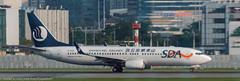 Shandong Airlines 737-800 leaving HKG (Alaskan Dude) Tags: travel asia hongkong hongkongairport planespotting planewatching aircraft airplane airplanes airlines aviation