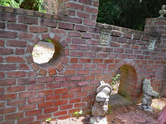 Castle Wall. (dccradio) Tags: middletown md maryand frederickcounty outdoor outdoors outside surreybrooke surreybrookegardens june wednesday summer summertime wednesdaymorning morning goodmorning canon powershot elph 520hs brick bricks brickwall wall castlewall window doorway archway statue statues cat cats catstatue catstatues greenery foliage
