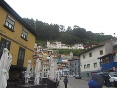 Cudillero, Asturias (d.kevan) Tags: villages houses hills trees colours streets windows doors terraces sunumbrellas people streetlamps towers balconies tables seats restaurants