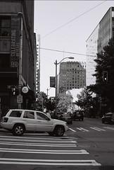 Seattle (goodfella2459) Tags: nikonf65 ilfordpanfplus50 35mm blackandwhite film analog city streets road buildings seattle washington bwfp