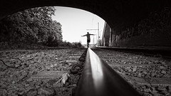 hobo (frax[be]) Tags: streetphotography tunnel railroad atmosphere fuji 16mm urban outdoor highcontrast silhouette noiretblanc monochrome fineart noir blackandwhite bnw bw composition