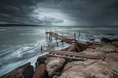 Heavy Sea (Christos Zoumides) Tags: sea nature wind waves water ocean storm heavysea winter mood melancholy overcast filters flow longexposure seascape shore rocks abandoned wood perspective light weather climate wbpa ngc cyprus avdimou limassol
