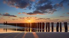 Bergen aan Zee (zsnajorrah) Tags: landscape landscapephotography seascape waterscape poles sea water reflection sky clouds sunset goldenhour longexposure neutraldensityfilter nd gnd breakthroughphotography x4nd10 tiffen gradnd sirui canon 7dmarkii ef1635mmf4l netherlands nederland northsea noordzee bergenaanzee dekerf nature