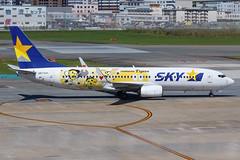 "Skymark Airlines B737-800(WL) JA73NR ""Hanshin Tigers"" 0021 (A.S. Kevin N.V.M.M. Chung) Tags: fukuoka fuk aviation aircraft aeroplane airport airlines plane spotting boeing b737 b737800wl speciallivery apron taxiing"