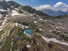 Lago Alto di Variola - Alta Val Bognanco (Italy) (Andrea Moscato) Tags: andreamoscato italia mountain montagna landscape light luce paesaggio parco park shadow nature natura natural naturale view vista vivid blue white green day snow alpi alps water freshwater lake ice stones rock lago hiking trail overlook drone dji mavic air quadcopter fly trekking sky cielo clouds nuvole valle valley vallata