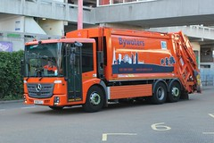 Bywaters Ltd . London . 168 DF68FCJ . Harlow Bus Station , Essex . Friday 05th-July-2019 . (AndrewHA's) Tags: essex harlow lorry truck dustcart bywaters mercedes benz 168 df68fcj rubbish trash recycling waste orange