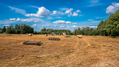 Farmland (free3yourmind) Tags: farm farmland rural agriculture clouds cloudy day blue sky hay bales poland harvest