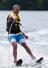 WPB_0582 (Paxton Blanchard) Tags: lake winnipesaukee women watersports waves water boats men game tubing nh newhampshire waterskiing sunset sun sunglasses people portrait sports canon canon70200 canon1dx 1dx crash spray blue panning
