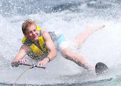 WPB_0491 (Paxton Blanchard) Tags: lake winnipesaukee women watersports waves water boats men game tubing nh newhampshire waterskiing sunset sun sunglasses people portrait sports canon canon70200 canon1dx 1dx crash spray blue panning
