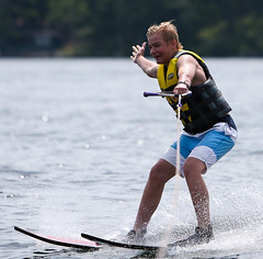 WPB_0446 (Paxton Blanchard) Tags: lake winnipesaukee women watersports waves water boats men game tubing nh newhampshire waterskiing sunset sun sunglasses people portrait sports canon canon70200 canon1dx 1dx crash spray blue panning