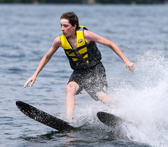WPB_0417 (Paxton Blanchard) Tags: lake winnipesaukee women watersports waves water boats men game tubing nh newhampshire waterskiing sunset sun sunglasses people portrait sports canon canon70200 canon1dx 1dx crash spray blue panning