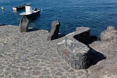 Los Abrigos, Tenerife, Canary Islands (wildhareuk) Tags: canaryislands canon canoneos500d habour losabrigos sea spain tamron18270mm tenerife tenerife2019 village wall water bench boat fishingboat rock standingstone tamron img9515dxo