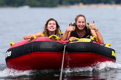 WPB_0316 (Paxton Blanchard) Tags: lake winnipesaukee women watersports waves water boats men game tubing nh newhampshire waterskiing sunset sun sunglasses people portrait sports canon canon70200 canon1dx 1dx crash spray blue panning