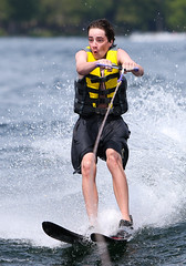 WPB_0412 (Paxton Blanchard) Tags: lake winnipesaukee women watersports waves water boats men game tubing nh newhampshire waterskiing sunset sun sunglasses people portrait sports canon canon70200 canon1dx 1dx crash spray blue panning