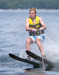 WPB_0524 (Paxton Blanchard) Tags: lake winnipesaukee women watersports waves water boats men game tubing nh newhampshire waterskiing sunset sun sunglasses people portrait sports canon canon70200 canon1dx 1dx crash spray blue panning