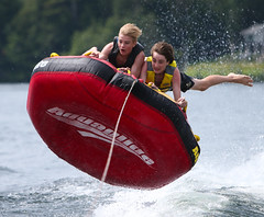 WPB_0259 (Paxton Blanchard) Tags: lake winnipesaukee women watersports waves water boats men game tubing nh newhampshire waterskiing sunset sun sunglasses people portrait sports canon canon70200 canon1dx 1dx crash spray blue panning