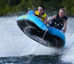 WPB_0167 (Paxton Blanchard) Tags: lake winnipesaukee women watersports waves water boats men game tubing nh newhampshire waterskiing sunset sun sunglasses people portrait sports canon canon70200 canon1dx 1dx crash spray blue panning