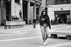 The Look (Silver Machine) Tags: london paternostersquare girl walking mobilephone sunglasses leatherjacket streetphotography street candid candideyecontact mono monochrome blackwhite bw fujifilm fujifilmxt3 fujinonxf35mmf2rwr