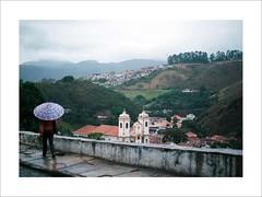 Umbrella (W Gaspar) Tags: ouropreto minasgerais minas brazil brasil southamerica latinamerica street rain woman photoborder analog film umbrella nikon nikkor f80 kodak ektar100 ektar iso100 2880mm mountains