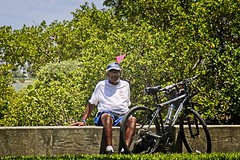 Seated Man with Bicycle (LarryJay99 ) Tags: fourthofjuly july4th2019 lakeworth blackman seated sittingpretty bike bicycle glasses legs urban people candid unposed unsyspecing delraybeach florida