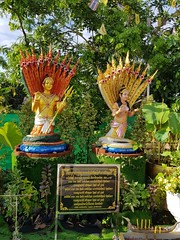 God and Goddss under nagas (SierraSunrise) Tags: animals buddhism esarn idols insects isaan lepidoptera nongkhai phonphisai religion statues thailand