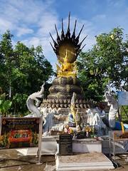 Buddha under Naga (SierraSunrise) Tags: buddhism esarn idols isaan nongkhai phonphisai religion statues thailand