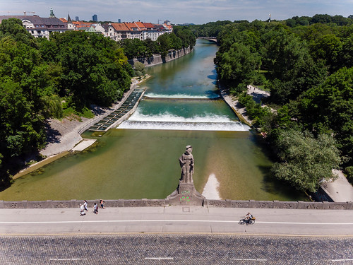 Aerial view of the Maximiliansbridge, with view of the weir and watertream of the small Isar Munich, Germany, next to the Maximilianeum
