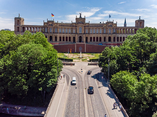 Aerial shot of the entrance of  Maximiliansbrücke and Maximilianeum, with its fountain, sight in Munich, Germany