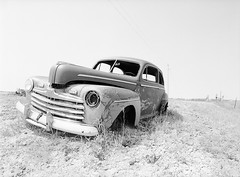 Old Ford (LarsHolte) Tags: pentax 645 pentax645 645n 6x45 smcpentaxa 35mm f35 120 film 120film analog analogue kosmo foto mono 100iso mediumformat blackandwhite classicblackwhite bw monochrome filmforever filmphotography aph09 rodinal ishootfilm larsholte homeprocessing usa southdakota scenic highway sd44 car wreck
