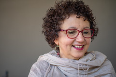 Smiling woman with scarf against isolated background (Rushay) Tags: woman curlyhair glasses scarf happy smile franschhoek southafrica
