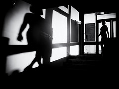 Shadow play (Sandy...J) Tags: street streetphotography sw schwarzweis shadow silhouette monochrom mood stimmung atmosphere blackwhite bw light darkness urban noir olympus fotografie photography licht lines linien women frau