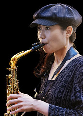 Portrait (D80_538776) (Itzick) Tags: denmark copenhagen candid colorportrait blackbackground youngwoman hat music saxophone preformer face facialexpression earrings streetphotography portrait d800 itzick