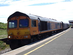 "GB Railfreight Class 66 66754 ""Northampton Saints"" (Alex S. Transport Photography) Tags: outdoor vehicle train railway rail freight class66 shed diesel locomotive loco wellingborough 4h03 66754 gbrf gbrailfreight northamptonsaints"