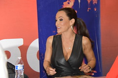 Lisa Ann at her Exxxotica table (hootervillefan) Tags: 2019 exxxotica chicago porn star expo convention hot sexy babes lisa ann lisaann legend black leather dress