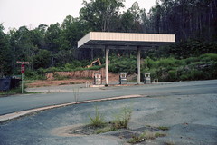 (patrickjoust) Tags: gatlinburg tennessee tn fujica gw690 kodak portra 160 120 6x6 medium format 90mm f35 fujinon lens cable release tripod long exposure early morning c41 color negative film manual focus analog mechanical patrick joust patrickjoust southern south smokey mountains gas station abandoned vacant empty trees forest construction site hickam hollow sign stop