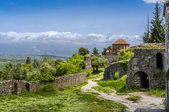 A lane in  Mystras (doveoggi) Tags: travel greece mystras 8961 church clouds