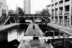 Regent's canal (a.pierre4840) Tags: olympus om3 zuiko 24mm f28 35mmfilm ilford ilfordhp5 hp5 hp5plus bw blackandwhite noiretblanc canal london england urban decay lock graffiti bridge architecture