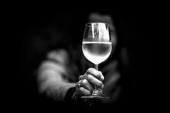 cheers to whatever is half full (Gerrit-Jan Visser) Tags: bnw cheers glass wine optimism full blackandwhite water