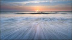 Perfect wave (Rob Schop) Tags: zeeland longexposure motionblur symmetry sonya6000 samyang12mmf20 nd64 hoyaprofilters seascape sunset highkey softtones poles waves singleexposure lrcc