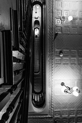 Things are Looking Up (BeerAndLoathing) Tags: newmexico rp newmexicotrip abstract blackwhite vintage canon ceiling stairs historic blackandwhite usa roadtrip trips lasvegas lookingup staircase canonef1740mmf4lusm canoneosrp spring bw 2019 nm april